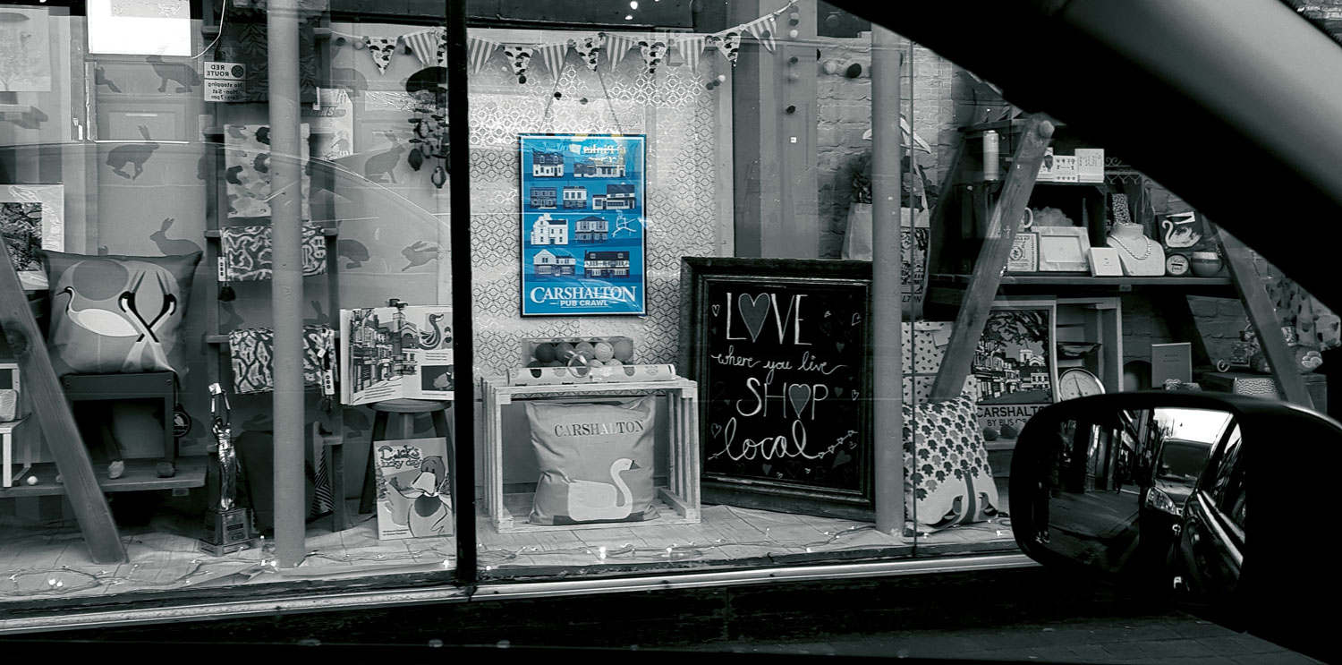 Calladoodles shop window with poster