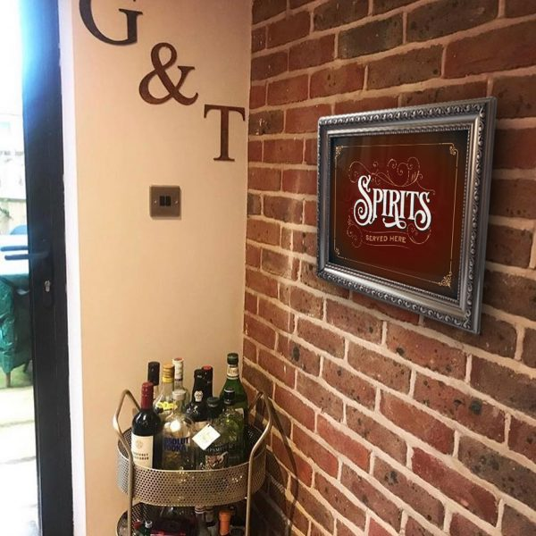 Spirits sign by G&T trolley